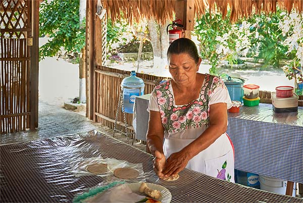 Making tortillas Mayan Experience Tour